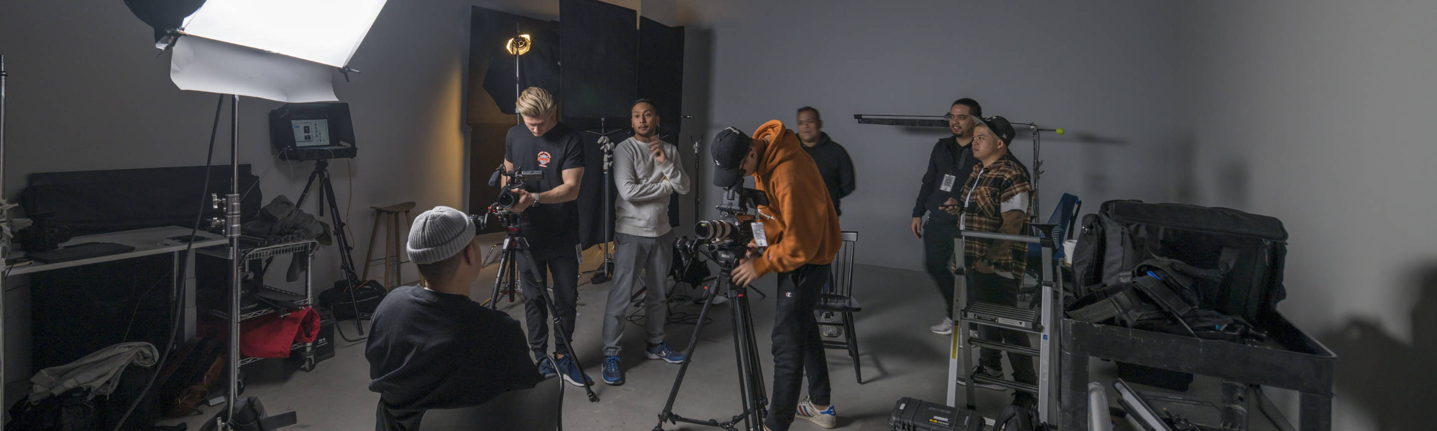 Person on a chair being filmed by production crew