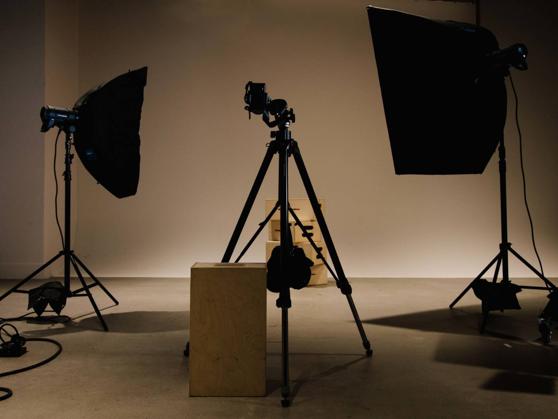 Camera tripod and lighting gear n the dim Photography studio